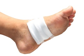 24176226 - gauze bandage the foot,treating patients with foot ulcers